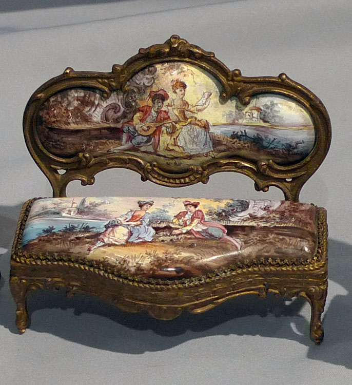 Fine Set Of Miniature Austrian Hand Painted Enamel And Gilt Bronze Furniture.  Including A Table With Hinged Lid With Finely Painted Top, A Sofa, ...