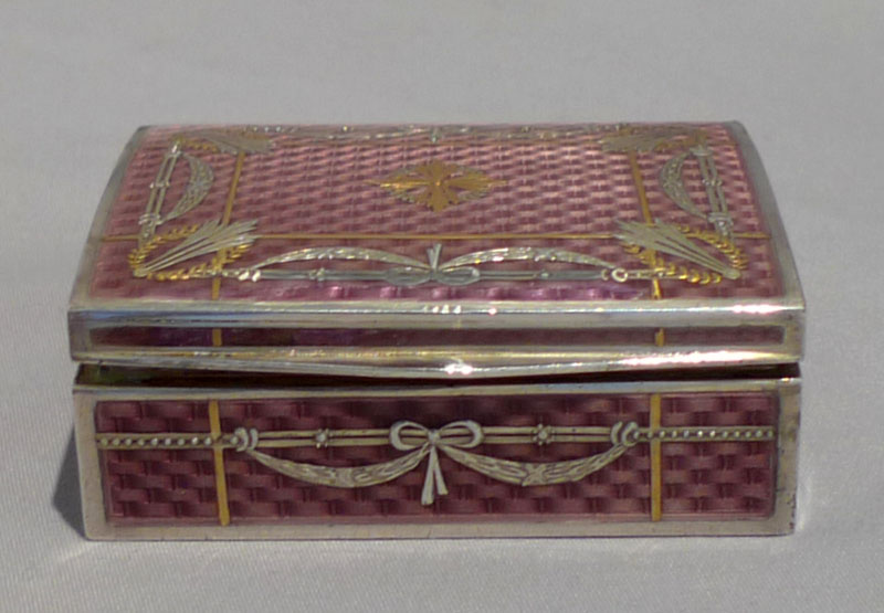 Antique silver and fine guilloche enamel pill box with applied gold mounts.