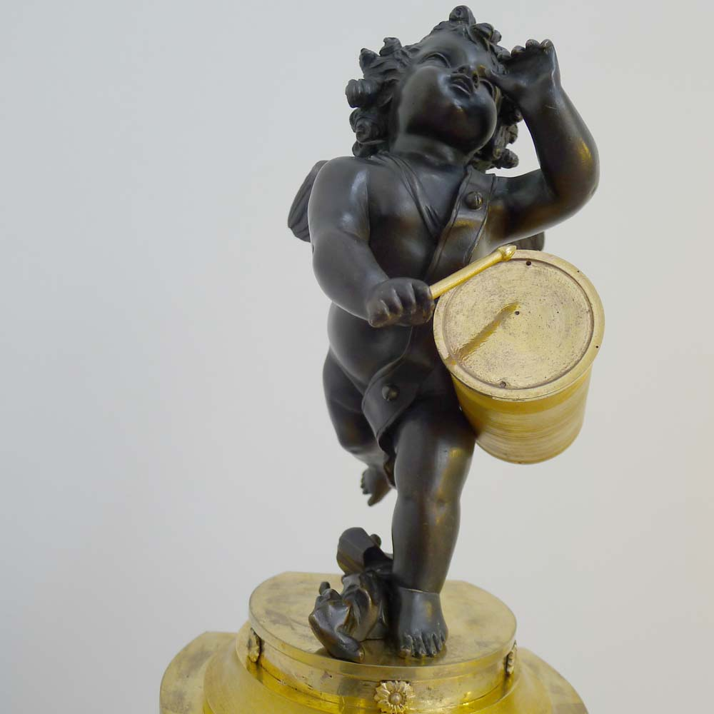 antique french ist empire clock in patinated bronze and ormolu of cupid playing a drum gavin. Black Bedroom Furniture Sets. Home Design Ideas