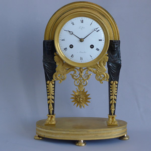 Antique French Directoire Egyptian style ormolu and patinated bronze mantel clock signed Leclerc.