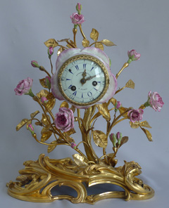 Fine Louis XVth 18th century  porcelain and ormolu mantel clock by Etienne Lenoir