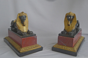 Antique Pair of Grand Tour Sphinxs in Ormolu, patinated bronze and Red and black marble