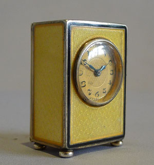 Sub miniature carriage clock in lemon yellow guilloche enamel and silver gilt.