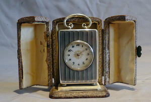 Antique, cased solid silver engine turned sub-miniature carriage clock.