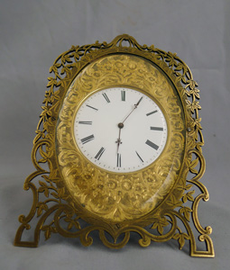 Mid 19th century gilt bronze strut clock in the style of Cole.