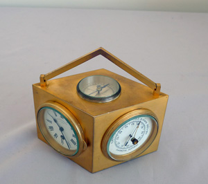 Antique weather station desk clock in an ormolu diamond shaped case.