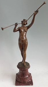 Antique French Napoleon III Bronze pipe girl on shaped rouge marble base.