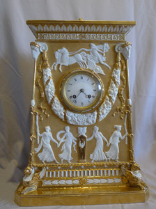 Antique Neo-classical gilded and natural bisque mantel clock.