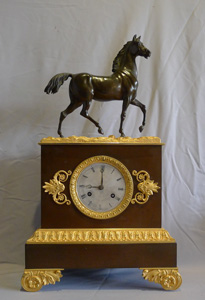 Antique French Charles X period patinated bronze and ormolu mantel clock of a stallion.