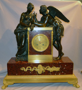 Antique French monumental version of Psyche and Cupid in rouge marble, patinated bronze and ormolu.