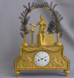 Rare French Directoire ormolu mantel clock of Josephine sitting in a bower