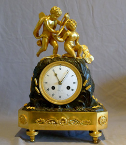 Antique and exceptionally rare French Empire mantel clock of two cupids signed Coeur