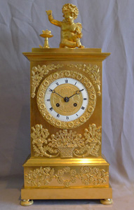 Antique French Charles X ormolu mantel clock depicting Love.