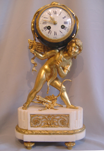 French antique Napoleon III mantel clock of Cupid carrying time.