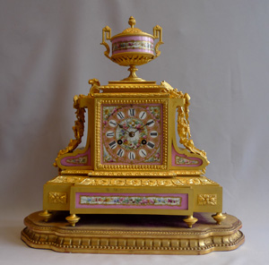 French antique pink porcelain and ormolu mantel clock.