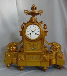 Antique French porcelain and ormolu mantel clock stamped in bronze H. Picard. And numbered
