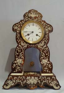 Antique French Portico clock of rosewood inlaid with ivory.