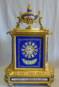 Antique French ormolu and hand painted porcelain on a cobalt blue ground.