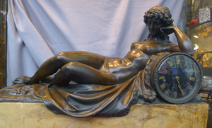 Massive Antique French clock of baccanalian maiden lying naked on Lion's skin. Model by Clodion.