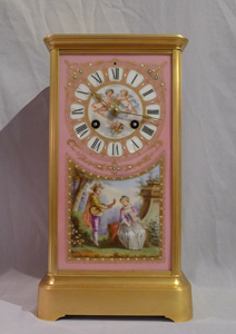 Antique French Napoleon III ormolu and porcelain sided mantel clock in four glass form.