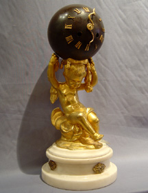Antique French white marble, patinated bronze and ormolu globe clock.
