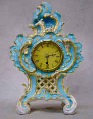 Antique English Coalbrookdale porcelain cased Vulliamy mantel clock.