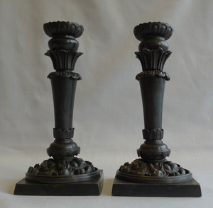 Pair English late Regency patinated bronze candlesticks.