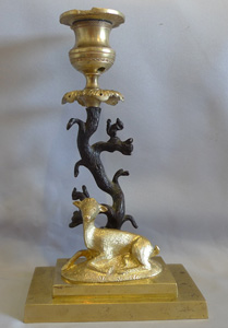 Antique English Regency candlestick of deer and squirrels in patinated bronze and ormolu.