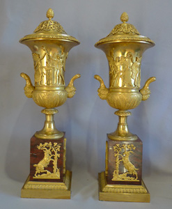 Antique true pair of neo-classical ormolu and rouge marble covered urns, probably Russian.