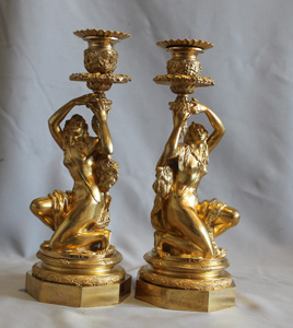 Antique Pair of French ormolu candlesticks celebrating viticulture.
