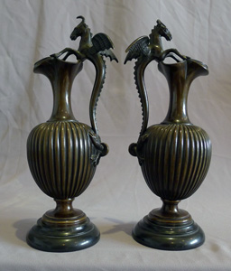 Antique pair of fine patinated bronze and marble urns probably Italian.