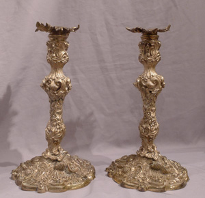 Antique pair of French ormolu candlesticks in the Louis XVth rococco style.
